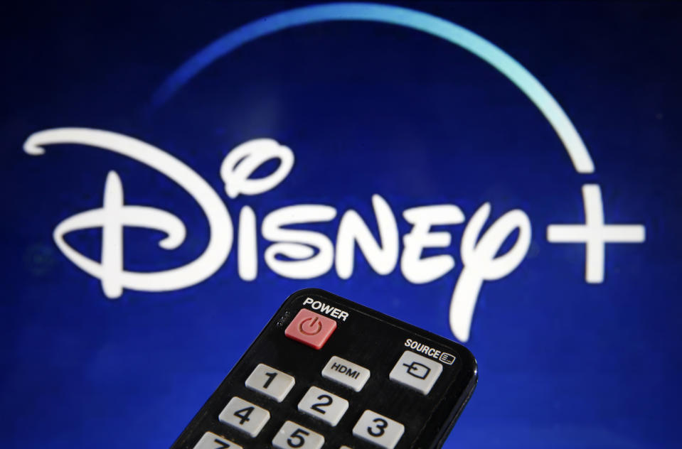 PARIS, FRANCE - MARCH 28: In this photo illustration, a remote control is seen in front of a television screen showing a Disney + logo on March 28, 2020 in Paris, France. At the request of the French government, the Disney + streaming platform has decided to postpone its launch in France to April 7. (Photo Illustration by Chesnot/Getty Images)