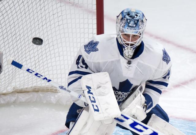 Toronto Maple Leafs goalie Jonathan Bernier deflects a shot during the first period of an NHL hockey game against the Montreal Canadiens Saturday, Nov. 30, 2013 in Montreal. (AP Photo/The Canadian Press, Paul Chiasson)