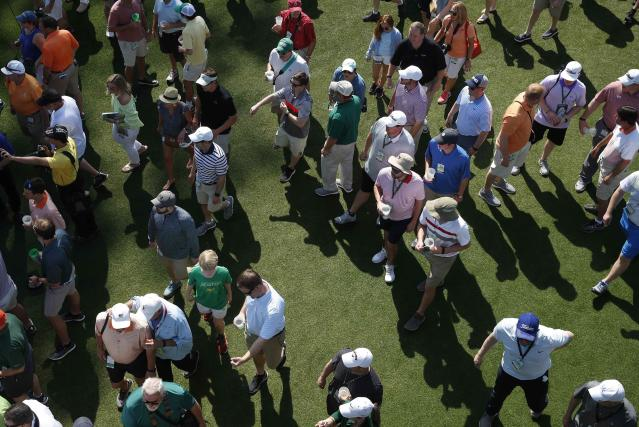 Golf patrons attend the second day of practice for the 2018 Masters golf tournament at Augusta National Golf Club in Augusta, Georgia, U.S. April 3, 2018. REUTERS/Mike Segar