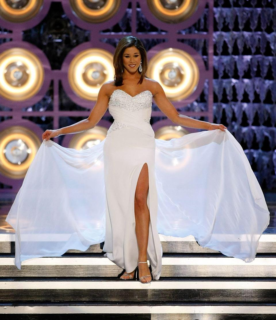<p>Although Kristy Cavinder of California didn't take home the title in 2010, her ethereal white gown was absolutely stunning. The sweetheart neckline was popular for the time, but the sheer train is what really made it stand out.</p>