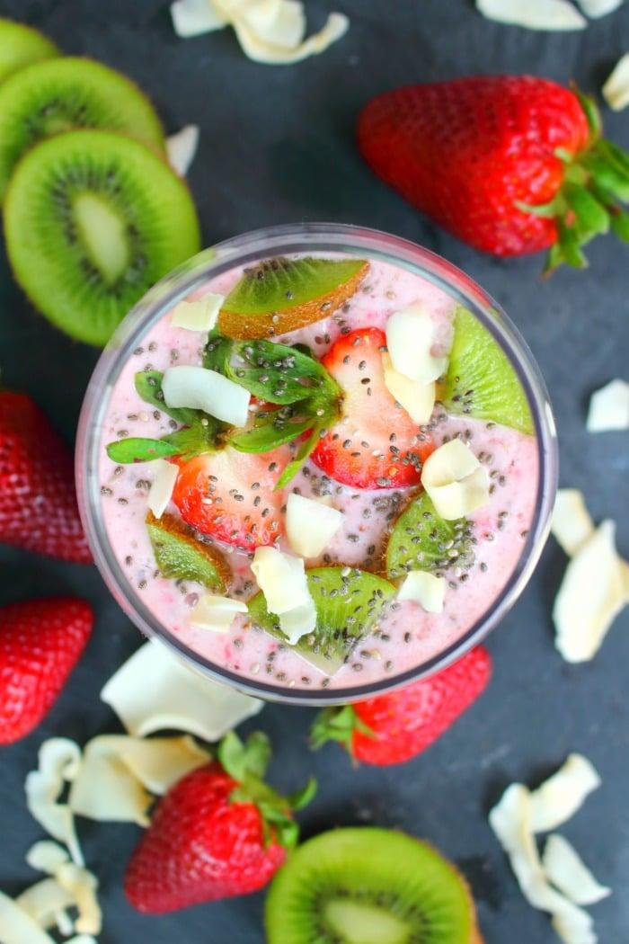 """<p>Strawberries, Greek yogurt, kiwis, almond milk, and chia seeds make this vitamin-packed smoothie one to remember. Top it off with coconut flakes to take your taste buds to paradise.</p> <p><strong>Get the recipe:</strong> <a href=""""https://delightfulemade.com/2017/05/01/easy-strawberry-kiwi-smoothie/"""" class=""""link rapid-noclick-resp"""" rel=""""nofollow noopener"""" target=""""_blank"""" data-ylk=""""slk:strawberry kiwi smoothie"""">strawberry kiwi smoothie</a></p>"""
