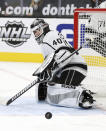 Los Angeles Kings goalie Calvin Petersen (40) watches the puck after making a save during the second period of an NHL hockey game against the Vegas Golden Knights Sunday, Feb. 7, 2021, in Las Vegas. (AP Photo/Isaac Brekken)