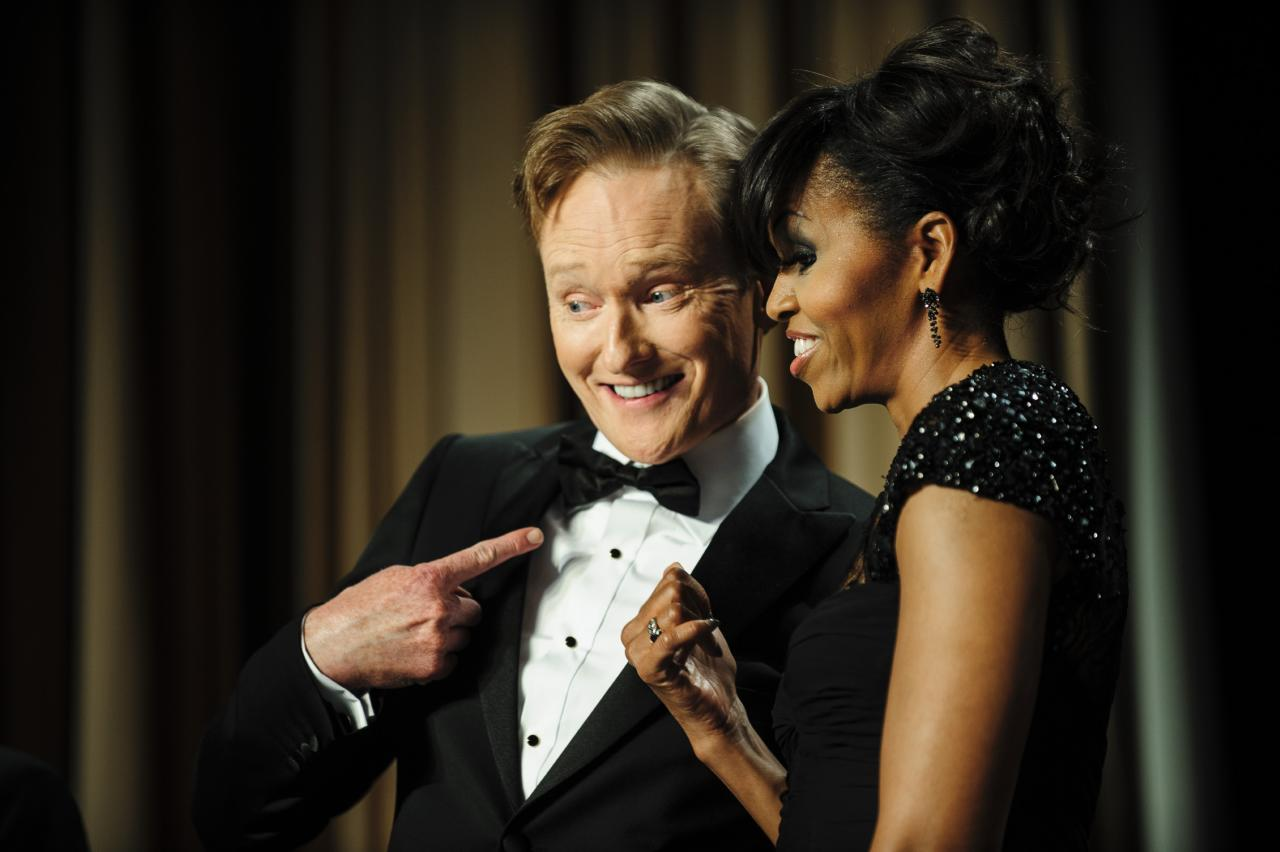 WASHINGTON, DC - APRIL 27:  Comedian Conan O'Brien and first lady Michelle Obama pose for the cameras during the White House Correspondents' Association Dinner on April 27, 2013 in Washington, DC. The dinner is an annual event attended by journalists, politicians and celebrities. (Photo by Pete Marovich-Pool/Getty Images)