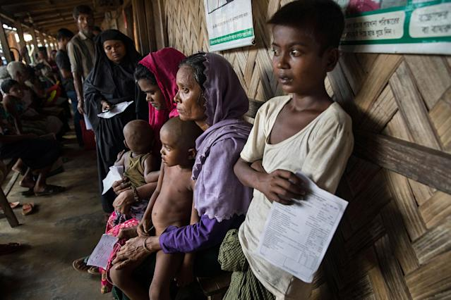 <p>Patients wait for medical treatment in the urgent out patient waiting area at the 'Doctors Without Borders' Kutupalong clinic on October 4, 2017 in Cox's Bazar, Bangladesh. Doctors Without Borders has been providing comprehensive basic healthcare services at their Kutupalong clinic since 2009. Due to the current Rohingya crisis, the clinic has expanded it's inpatient capacity dealing with approximately 2,500 out patient treatments and around 1,000 emergency room patients per week. All healthcare services provided at the clinic are free of charge to both the Rohingya refugee population as well as local Bangladeshi patients. Doctors Without Borders has also set up a number of health posts, mobile clinics and water and sanitation services elsewhere in Cox's Bazar to better respond to the influx. Well over a half a million Rohingya refugees have fled into Bangladesh since late August during the outbreak of violence in Rakhine state causing a humanitarian crisis in the region with continued challenges for aid agencies. (Photograph by Paula Bronstein/Getty Images) </p>