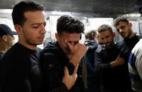 Relatives mourn during the funeral of Reema Telbani and her 5-year-old son Zaid, who were killed in Israeli airstrikes on their family apartment building, at Dar Al-Shifa Hospital in Gaza City, Wednesday, May 12, 2021. (AP Photo/Adel Hana)
