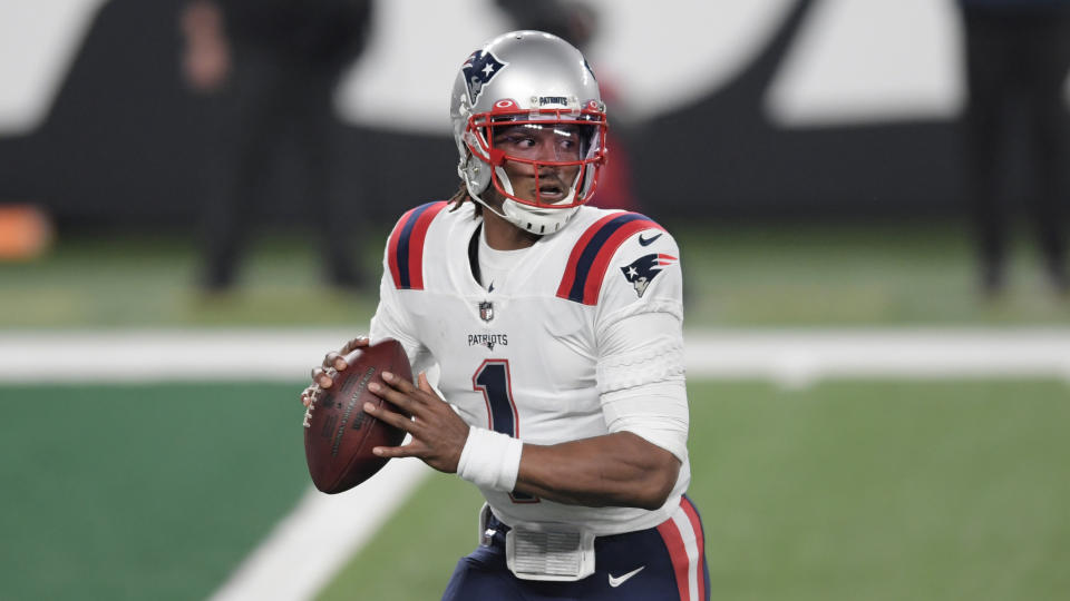 New England Patriots quarterback Cam Newton looks to throw during the first half of an NFL football game against the New York Jets, Monday, Nov. 9, 2020, in East Rutherford, N.J. (AP Photo/Bill Kostroun)