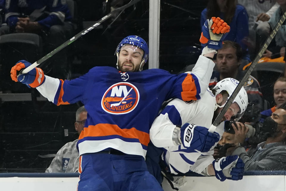 New York Islanders defenseman Adam Pelech (3) collides with Tampa Bay Lightning right wing Nikita Kucherov (86) during the first period of Game 3 of the NHL hockey Stanley Cup semifinals, Thursday, June 17, 2021, in Uniondale, N.Y. (AP Photo/Frank Franklin II)