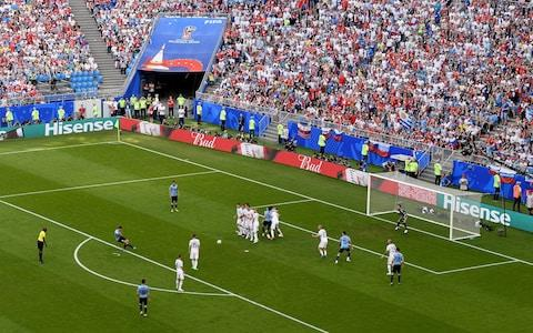 Luis Suarez of Uruguay scores his team's first goal during the 2018 FIFA World Cup Russia group A match between Uruguay and Russia at Samara Arena on June 25, 2018 in Samara, Russia