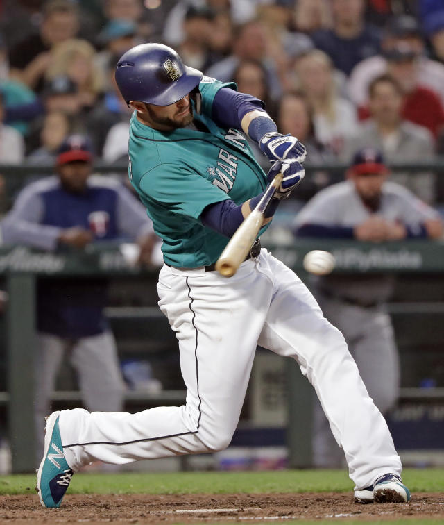 Seattle Mariners' Mitch Haniger singles in a run against the Minnesota Twins during the sixth inning of a baseball game Friday, May 25, 2018, in Seattle. (AP Photo/Elaine Thompson)