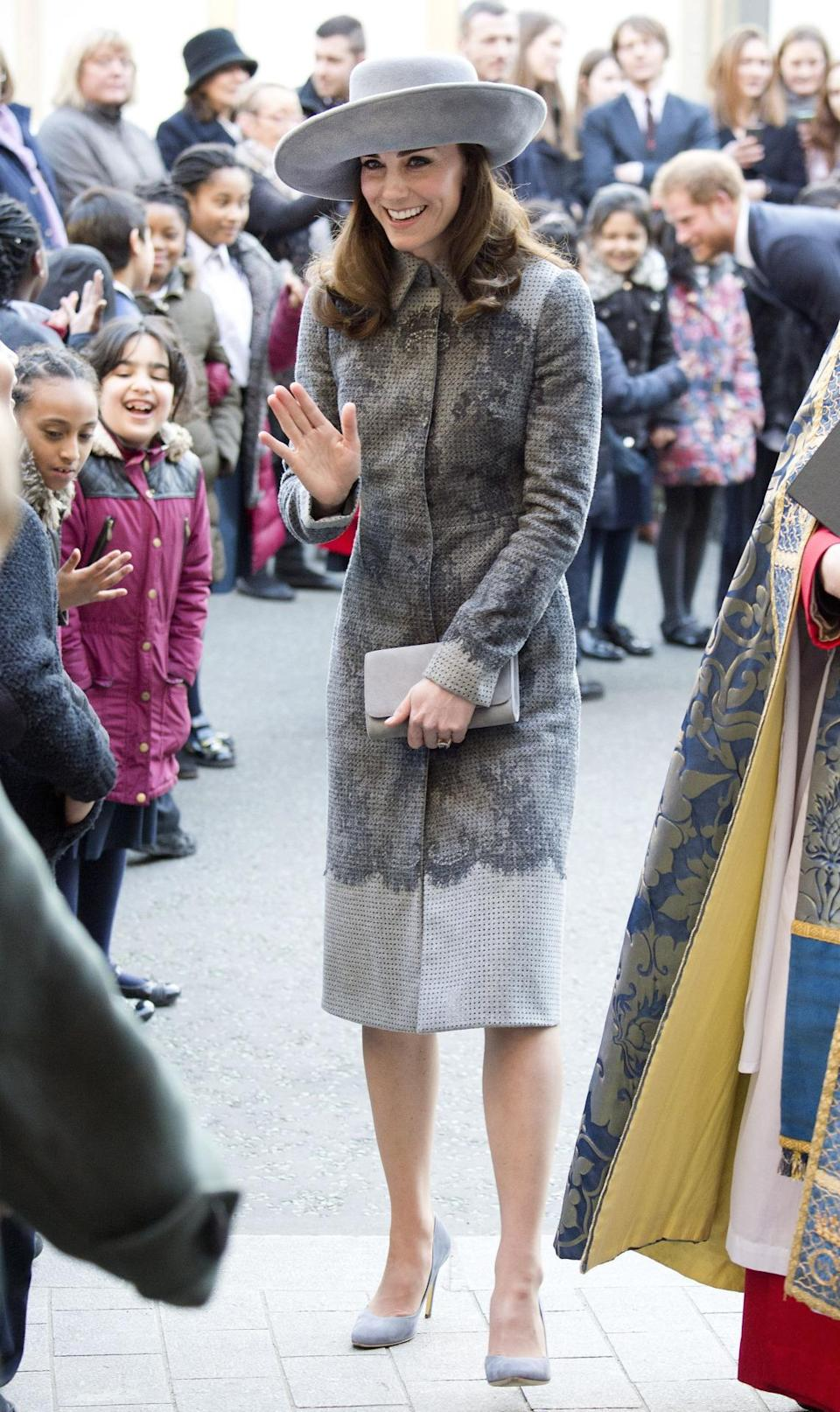 <p>London-based designer Erdem was the man behind Kate's lacy grey coat. For a service at Westminster Abbey, the Duchess accessorised with suede Rupert Sanderson heels and a wide-brimmed hat by John Boyd. </p><p><i>[Photo: PA]</i></p>