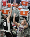 Los Angeles Clippers' Ivica Zubac, left, dunks over Detroit Pistons' Mason Plumlee during the first half of an NBA basketball game Sunday, April 11, 2021, in Los Angeles. (AP Photo/Jae C. Hong)