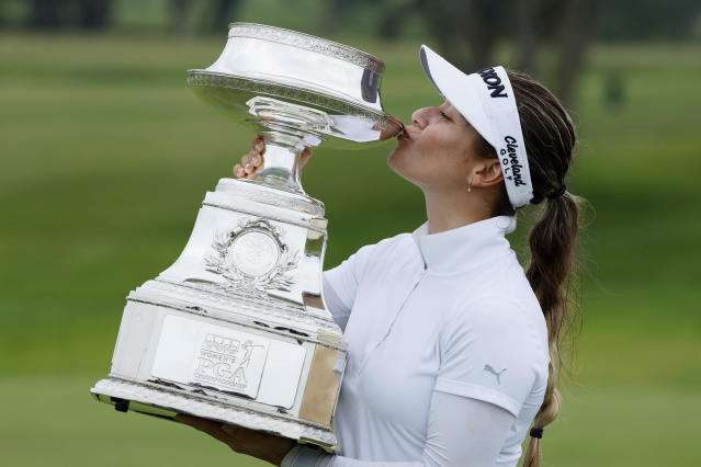 Hannah Green, of Australia, kisses the trophy after winning the KPMG Women's PGA Championship golf tournament, Sunday, June 23, 2019, in Chaska, Minn. (AP Photo/Charlie Neibergall)