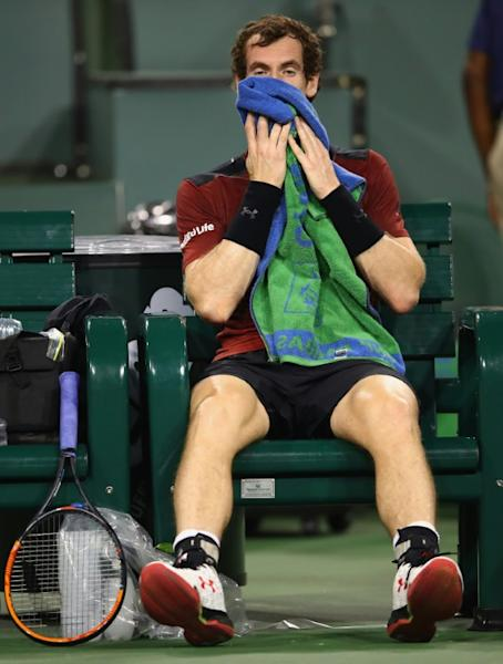 Andy Murray of Great Britain shows his dejection during his straight sets defeat by Vasek Pospisil of Canada in their BNP Paribas Open second round match, at Indian Wells Tennis Garden in California, on March 11, 2017