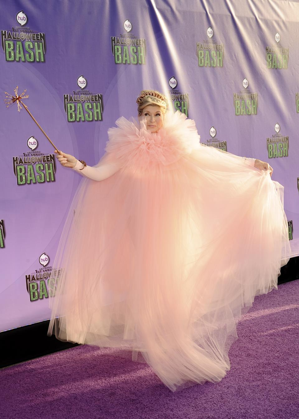 """<strong>Martha Stewart as Glinda the Good Witch</strong><br><br>In the musical <em>Wicked</em>, Glinda teaches Elphaba how to be """"popular"""" in a finishing school-like course that would make Martha Stewart proud. Stewart dressed up as the witch in 2013."""