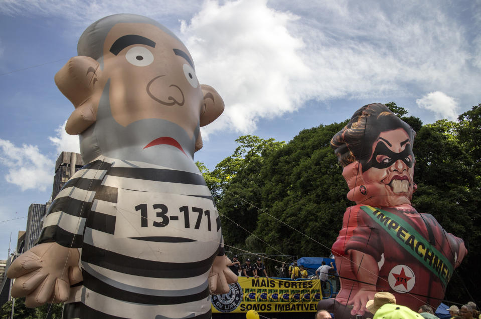São Paulo, Brazil - December 13, 2015: Large inflatable dolls in the likeness of former Brazilian president Lula da Silva and current president Dilma Rousseff  at a protest on Paulista Avenue, the location of many financial and cultural institutions in Sao paulo. Forty thousand people gathered on Paulista Avenue in Sao Paulo, Brazil to protest against the corruption on the government of Partido dos Trabalhadores (PT).