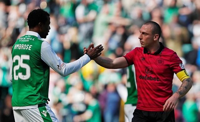 Soccer Football - Scottish Premiership - Hibernian v Celtic - Easter Road, Edinburgh, Britain - April 21, 2018 Hibernian's Efe Ambrose shakes hands with Celtic's Scott Brown after the match REUTERS/Russell Cheyne
