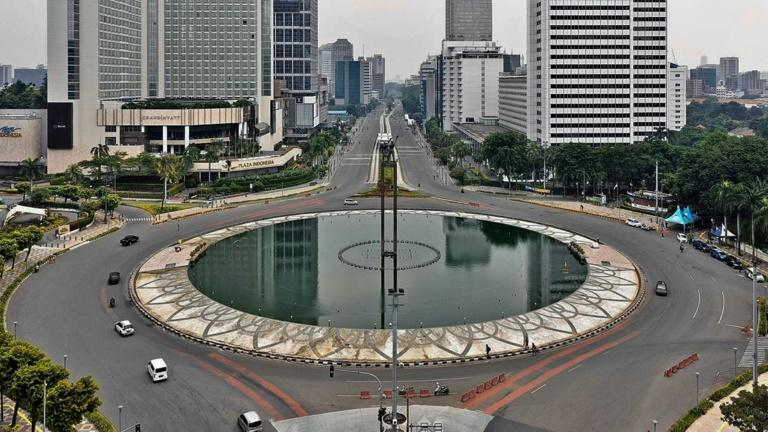 Roads in central Jakarta are deserted as tough social-distancing rules come into force with residents told to stay at home