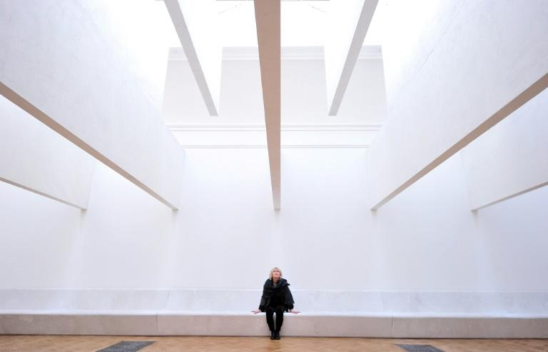 Irish architect Yvonne Farrell, a newly minted Pritzker laureate, poses next to her installation at the Royal Academy of Arts in central London in 2014