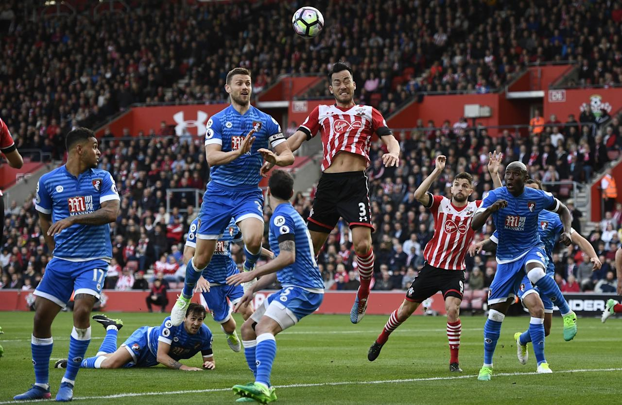 <p>Southampton's Maya Yoshida in action with Bournemouth's Simon Francis </p>