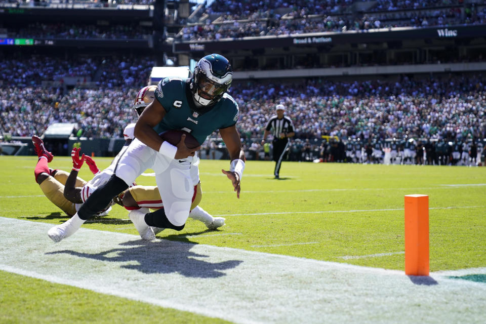 Philadelphia Eagles quarterback Jalen Hurts (1) is forced out of bounds during the first half of an NFL football game against the San Francisco 49ers on Sunday, Sept. 19, 2021, in Philadelphia. (AP Photo/Matt Rourke)