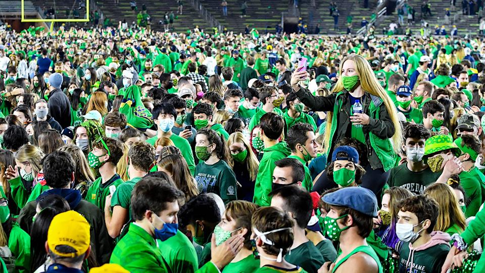 Fans, pictured here on the field after Notre Dame defeated Clemson.