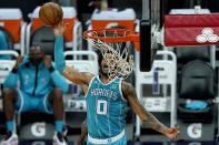 Charlotte Hornets forward Miles Bridges (0) is fouled while shooting against the Phoenix Suns during the first half of an NBA basketball game, Wednesday, Feb. 24, 2021, in Phoenix. (AP Photo/Matt York)