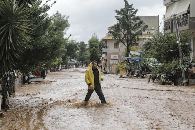 <p>Floods and mudslides have turned roads into fast-flowing rivers after torrential rains struck the west Athenian suburb of Mandra, Greece on Nov. 16, 2017. (Photo: Ayhan Mehmet/Anadolu Agency/Getty Images) </p>