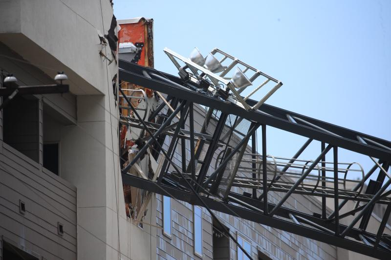 1 dead, at least 6 injured in crane collapse