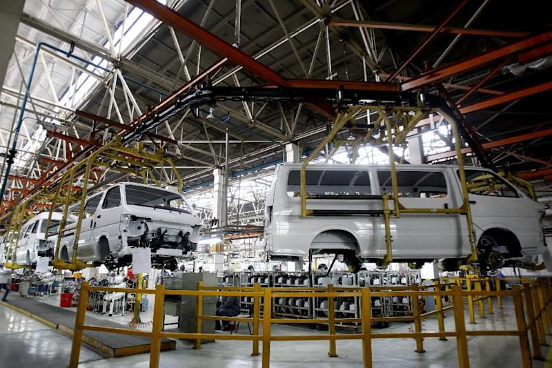 Cars are assembled in a workshop of an automobile factory in Shenyang, northeast China's Liaoning province