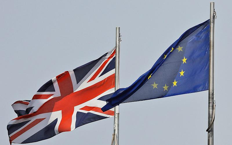 A Union Jack flag and a European flag blow in the wind in front of the city hall in London - Copyright 2016 The Associated Press. All rights reserved. This material may not be published, broadcast, rewritten or redistribu