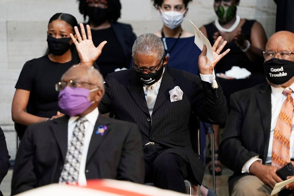 "<p>Representative Gregory Meeks (D-NY) raised his hands as ""Amazing Grace"" played during the memorial service. </p>"