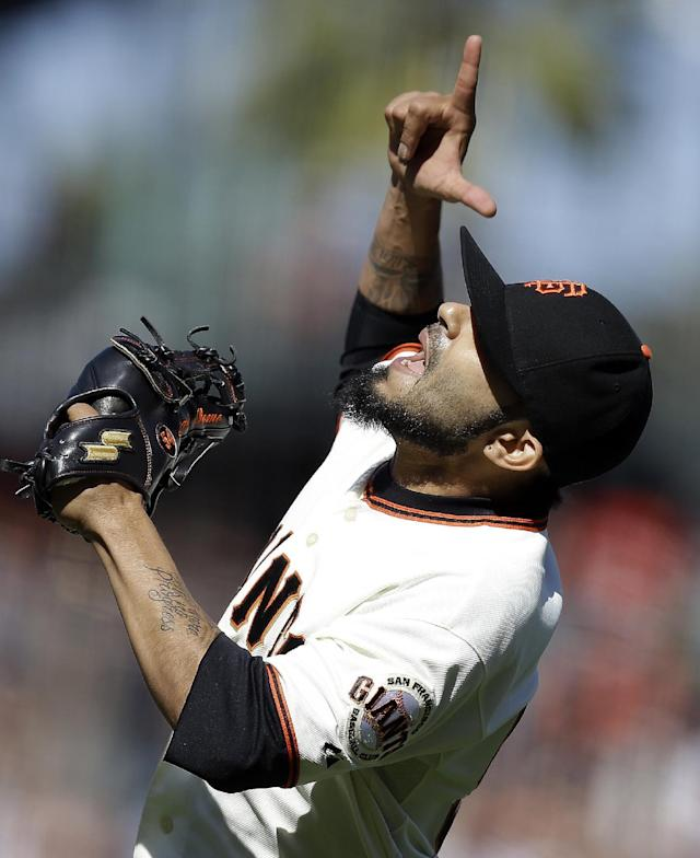 San Francisco Giants' Sergio Romo reacts after the 3-2 defeat of the Baltimore Orioles at the end of a baseball game, Saturday, Aug. 10, 2013, in San Francisco. (AP Photo/Ben Margot)