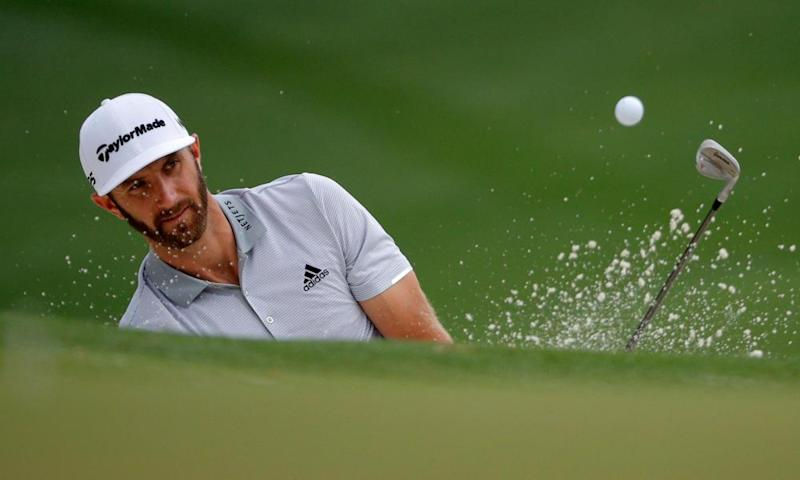 Dustin Johnson chips onto the 10th green during Wednesday practice for the 2017 Masters at Augusta.