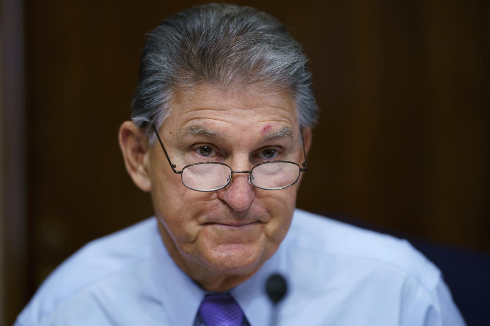 """FILE - In this Aug. 5, 2021, file photo Sen. Joe Manchin, D-W.Va., prepares to chair a hearing in the Senate Energy and Natural Resources Committee, as lawmakers work to advance the $1 trillion bipartisan bill, at the Capitol in Washington. Manchin said Thursday, Sept. 2, that Congress should take a """"strategic pause"""" on more spending, warning that he does not support President Joe Biden's plans for a sweeping $3.5 trillion effort to rebuild and reshape the economy. (AP Photo/J. Scott Applewhite, File)"""