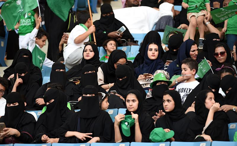 Women commemorate the anniversary of Saudi Arabia's founding at King Fahd International Stadium in Riyadh on Sept. 23, 2017. Strict rules on public segregation of the sexes have effectively barred women in Saudi Arabia from entering sports arenas.