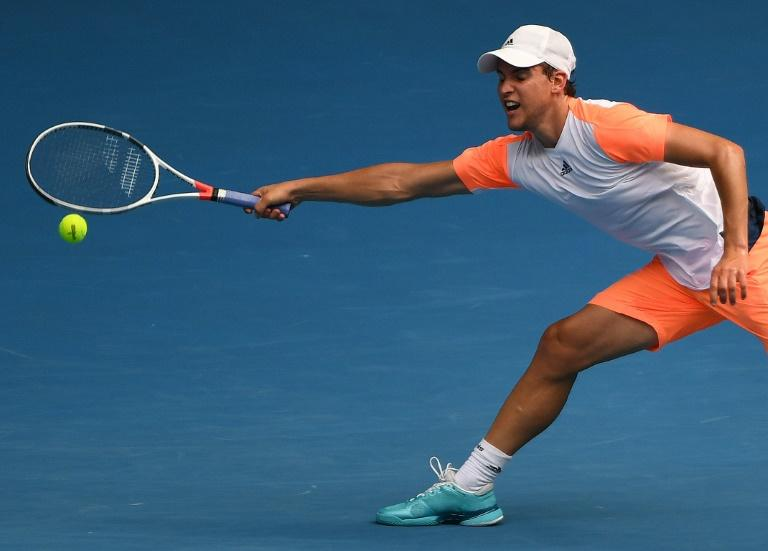 Austria's Dominic Thiem hits a return against Belgium's David Goffin during their men's singles fourth round match on day eight of the Australian Open tennis tournament in Melbourne on January 23, 2017