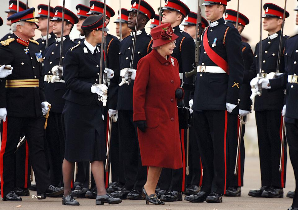 <p>Prince William inspected by his grandmother, the Queen , as he takes part in the Sovereign's Parade at the Royal Military Academy Sandhurst in December 2006. (Anwar Hussein)</p>