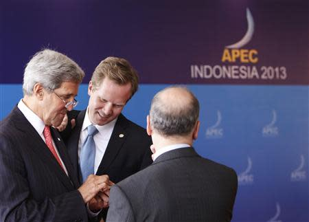U.S. Secretary of State John Kerry (L) waits to depart after the Asia-Pacific Economic Cooperation (APEC) Leaders Press Conference and Joint Declaration in Nusa Dua, on the Indonesian resort island of Bali October 8, 2013. REUTERS/Edgar Su