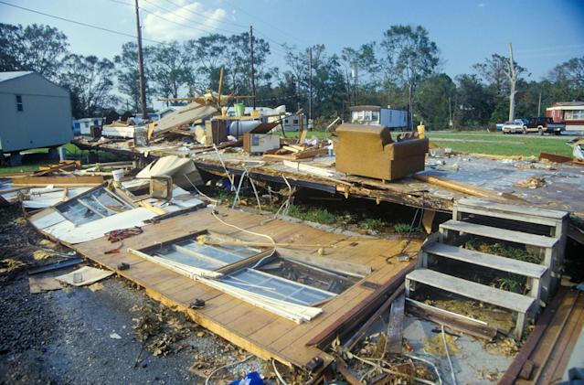 <p>Hurricane Andrew left one trailer home in complete ruins and surrounding homes untouched in Jeanerette, LA (Visions of America/UIG via Getty Images) </p>
