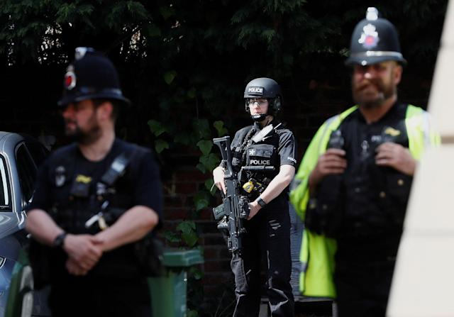<p>Armed and uniformed police officers stand outside a residential property near to where a man was arrested in the Chorlton area of Manchester, Britain on May 23, 2017. (Stefan Wermuth/Reuters) </p>