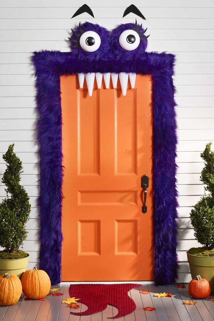 """<p>Rely on the laughs — not frights — with this fuzzy, friendly monster, plastic fangs and all. Go for a faux fur shade that complements your door's paint, so it doesn't clash.</p><p><em><a href=""""https://www.womansday.com/home/crafts-projects/how-to/g309/9-devilishly-fun-decorating-projects-110896/"""" rel=""""nofollow noopener"""" target=""""_blank"""" data-ylk=""""slk:Get the tutorial at Woman's Day »"""" class=""""link rapid-noclick-resp"""">Get the tutorial at Woman's Day »</a></em></p>"""