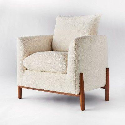 """<p><strong>Threshold x Studio McGee</strong></p><p>target.com</p><p><strong>$249.00</strong></p><p><a href=""""https://www.target.com/p/elroy-sherpa-accent-chair-with-wood-legs-cream-threshold-8482-designed-with-studio-mcgee/-/A-79501213"""" rel=""""nofollow noopener"""" target=""""_blank"""" data-ylk=""""slk:BUY NOW"""" class=""""link rapid-noclick-resp"""">BUY NOW</a></p><p>Featuring thick cushions with a fleecy sherpa exterior, this accent chair is as comfy as it looks. Get the <a href=""""https://www.target.com/p/elroy-sherpa-round-ottoman-with-wood-legs-cream-threshold-8482-designed-with-studio-mcgee/-/A-79516558"""" rel=""""nofollow noopener"""" target=""""_blank"""" data-ylk=""""slk:matching ottoman"""" class=""""link rapid-noclick-resp"""">matching ottoman</a> to make your seating extra cozy. </p>"""