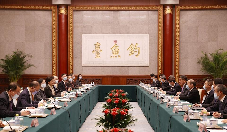 Carrie Lam (fourth left) meets with China's development chief He Lifeng. Photo: Handout