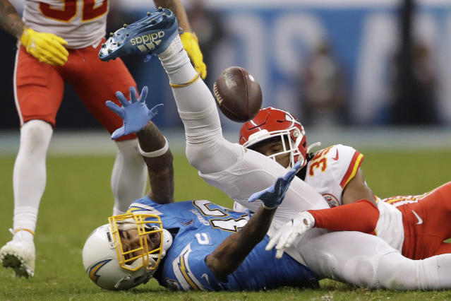 Los Angeles Chargers wide receiver Keenan Allen, left, can't make the catch as Kansas City Chiefs cornerback Charvarius Ward, right, defends, during the second half of an NFL football game Monday, Nov. 18, 2019, in Mexico City. (AP Photo/Marcio Jose Sanchez)