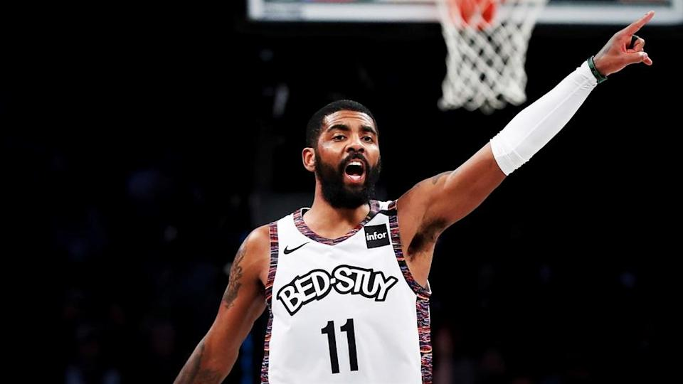 Brooklyn Nets guard Kyrie Irving (11) reacts