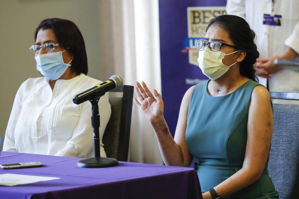 Mayra Ramirez, 28, of Chicago, received the first double-lung transplant at Northwestern Memorial Hospital, speaks at a news conference at the facility in Chicago on Thursday, July 30, 2020. Mayra's mother, Nohemi Romero, is seated at left. (Jose M. Osorio/Chicago Tribune/Tribune News Service via Getty Images)