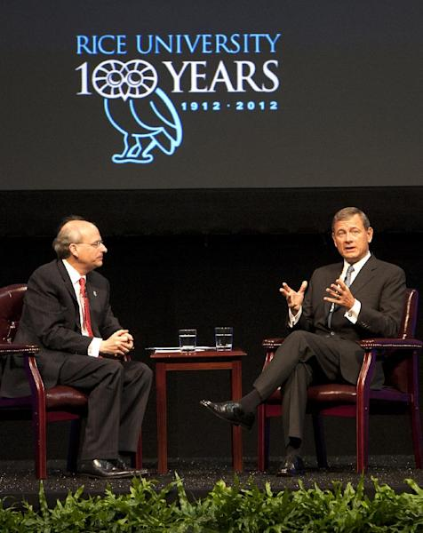 "Rice University President David Leebron, left, listens as U.S. Supreme Court Chief Justice John Roberts answers a question during ""A Conversation With the Chief Justice"" at Rice University Wednesday, Oct. 17, 2012, in Houston. Roberts was invited to speak in celebration of Rice's Centennial Celebration and Centennial Lecture Series. (AP Photo/Houston Chronicle, Cody Duty)"