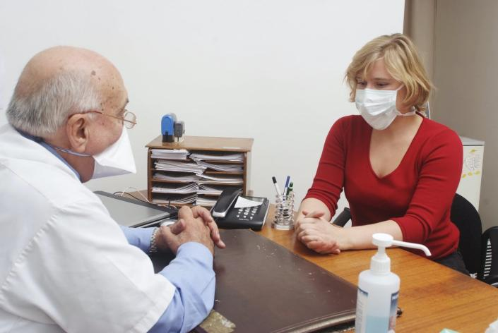 "<span class=""caption"">To prevent the spread of COVID-19, patients should wear a mask when seeing the doctor.</span> <span class=""attribution""><a class=""link rapid-noclick-resp"" href=""https://www.gettyimages.com/detail/news-photo/reconstructed-scene-in-doctors-office-news-photo/151060364?adppopup=true"" rel=""nofollow noopener"" target=""_blank"" data-ylk=""slk:Getty Images / BSIP"">Getty Images / BSIP</a></span>"