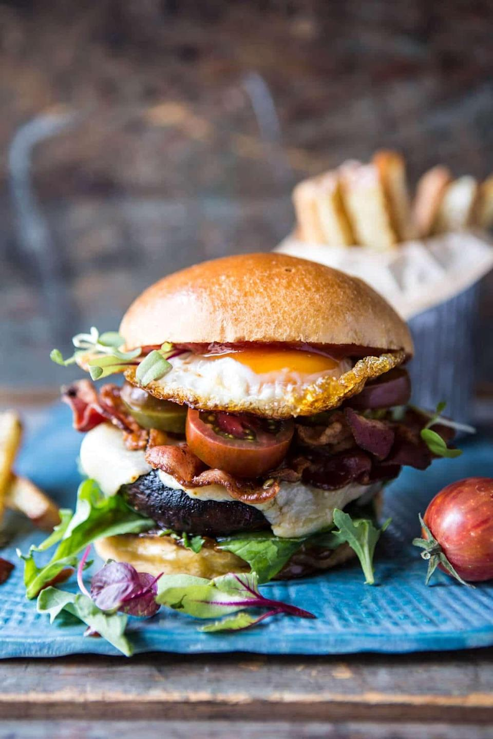 "<p>Adding bacon to a mushroom burger is one of the tastiest things you can do - trust us! You'll get the juicy meat mixed with the rich mushroom flavor to create a melt-in-your-mouth meal.</p> <p><strong>Get the recipe</strong>: <a href=""https://www.halfbakedharvest.com/cheddar-bacon-portobello-mushroom-burger/"" class=""link rapid-noclick-resp"" rel=""nofollow noopener"" target=""_blank"" data-ylk=""slk:cheddar bacon portobello mushroom burger"">cheddar bacon portobello mushroom burger</a></p>"