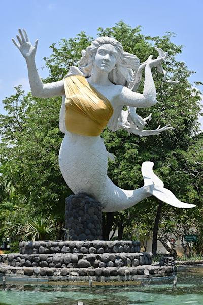 One of two mermaid statues covered up at the Ancol amusement park in Jakarta (AFP Photo/ADEK BERRY)
